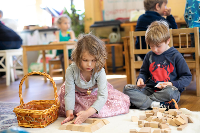 girl and boy with blocks